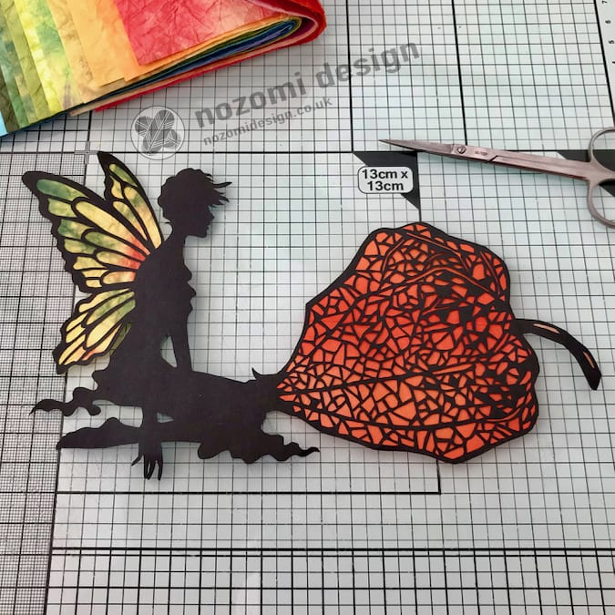 Adding washi paper to the cut-out.
