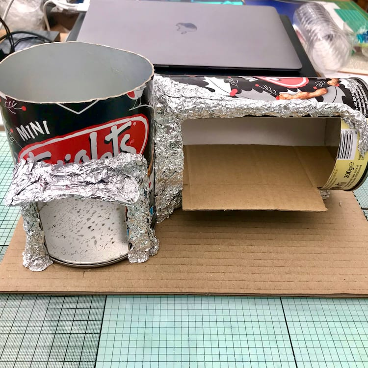 Using aluminium foil to mould the shape of the eaves.
